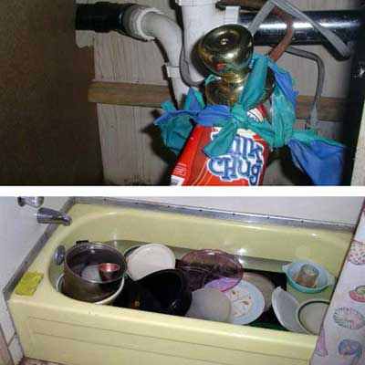 plumbing pipes held together with balloons, an electrical plug, a carton of 'Milk Chug' and a doorknob and a bathtub filled with dishes