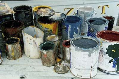 open paint cans releasing fumes