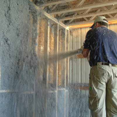 man spraying insulation