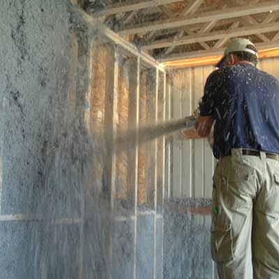 man spraying insulation