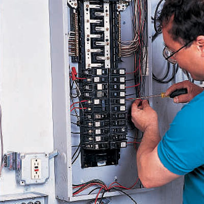 man expecting switches in breaker box