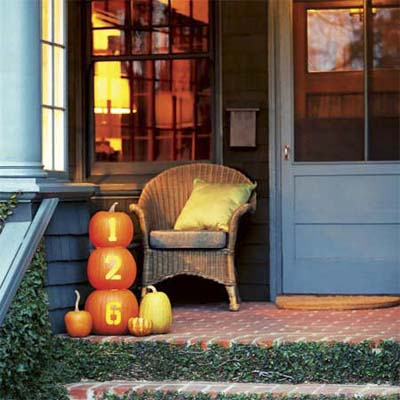decorated pumpkins used as themed house numbers