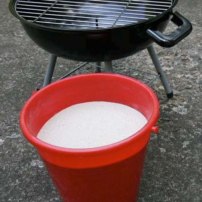 sand bucket next to grill