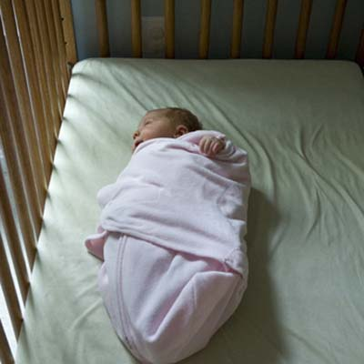 child home safety, child-proofing, and accidental injury prevention in the bedroom, nursery, crib: baby sleeping in crib