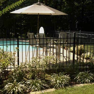 child home safety, child-proofing, and accidental injury prevention in the yard and near pools: backyard with fenced in swimming pool