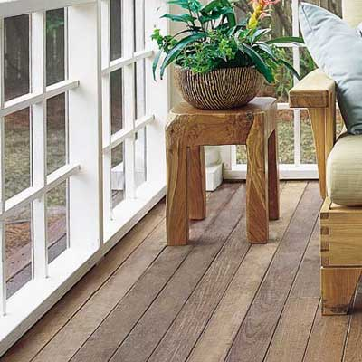 screened porch with wood floor