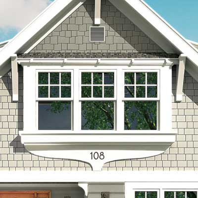a Photoshop rendering of a cottage redesign focusing on the window trim