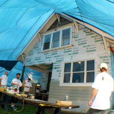 a whole-house tarp that covered the house and the job site