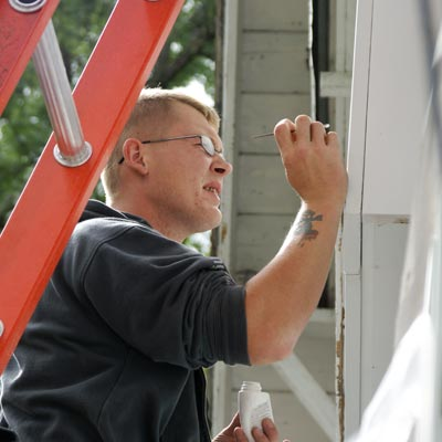 filling nail holes before applying new siding