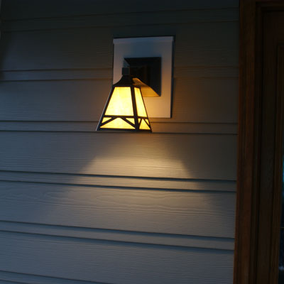the sconce in front of the remodeled Real-Life Photoshop Redo Contest winner