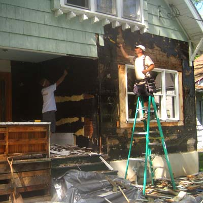 the homeowners help out with tearing off the original siding