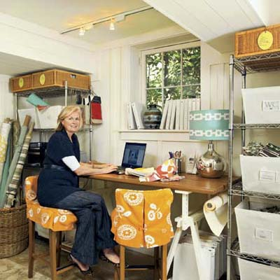 home owner working in the corner office she designed into the remodeled basement