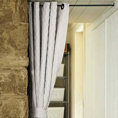 a soft canvas curtain used as a room divider in the remodeled basement