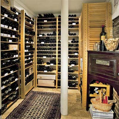 open wine racks built into a room of this remodeled basement make a fine wine cellar