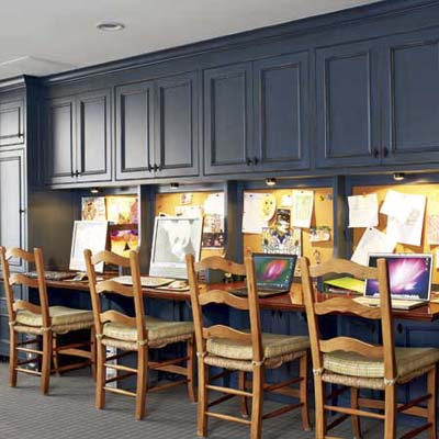homework center for four kids and their school supplies built into this basement remodel
