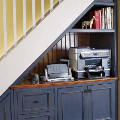 shared print station for the homework center built under the stairs as part of this basement remodel