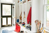 mudroom entryway with runner and shelf storage