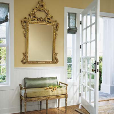 Entryway with ornate mirror and sitting bench