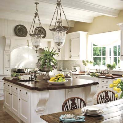 Open white kitchen has rustic charm