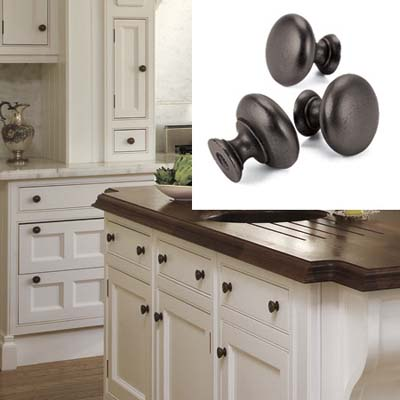 Bronze knobs stand out on white kitchen cabinets