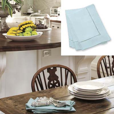 Blue dinner napkins add color to white kitchen