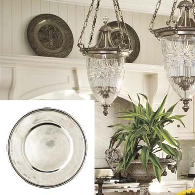 pewter chargers dress up a white kitchen wall