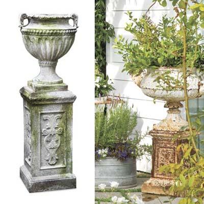 Antiqued urn hold overflowing greens in garden