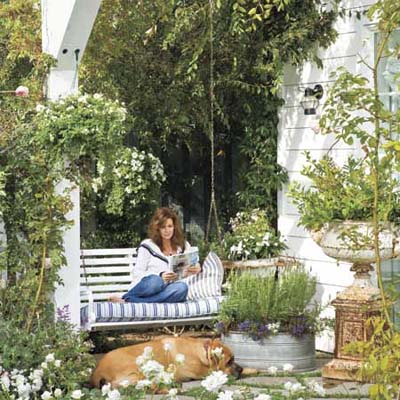 Overflowing garden with porch swing