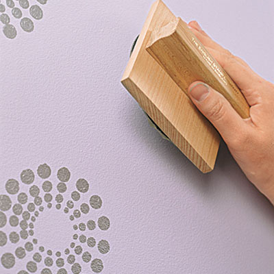 hand stamping paint on lavender walls
