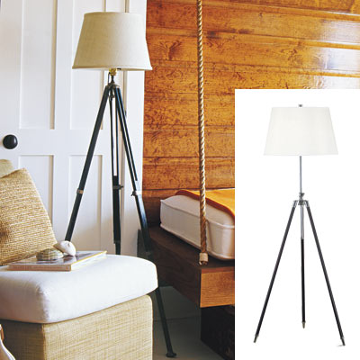 cabin style bedroom with tripod lamp