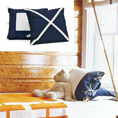cabin style bedroom with graphic nautical style accent pillows