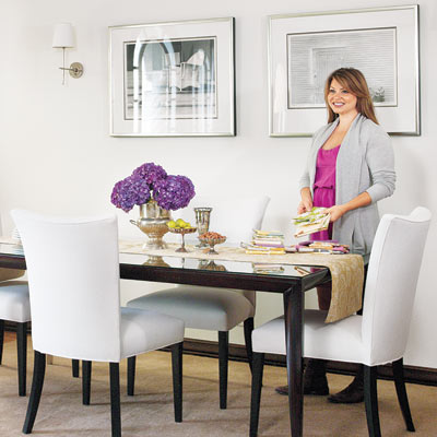 feminine dining room with woman folding napkins