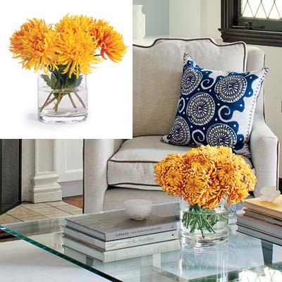 well furnished living room with yellow orange bouquet in glass vase