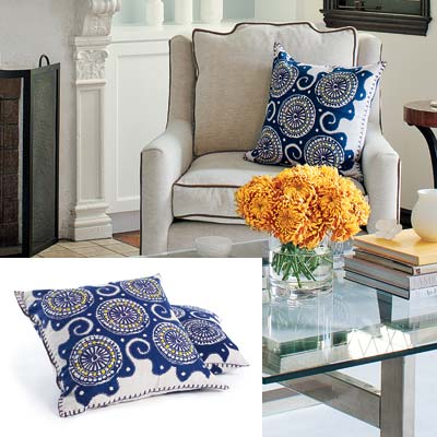 well furnished living room with graphic pillow covers