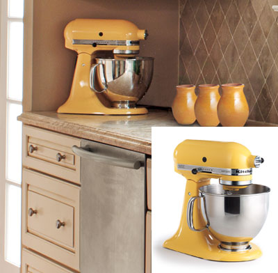 kitchen with taupe tile backsplash and yellow kitchenaid mixer