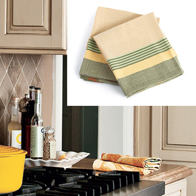 taupe kitchen with gold and green dish towels