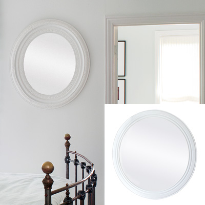light airy bedroom with round mirror