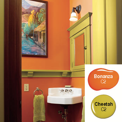 orange and green powder room with gaugin print