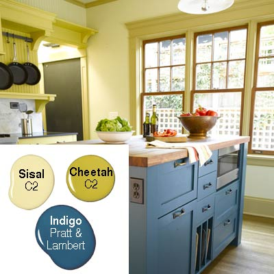 light olive green kitchen with darker trim and blue island