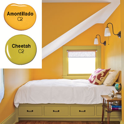 guest bedroom with saffron yellow orange walls and built in bed
