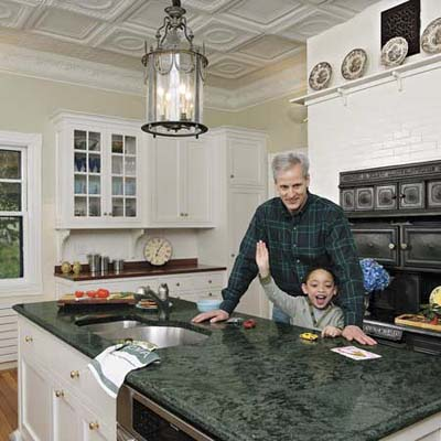 man and his son at the kitchen island in their remodeled kitchen