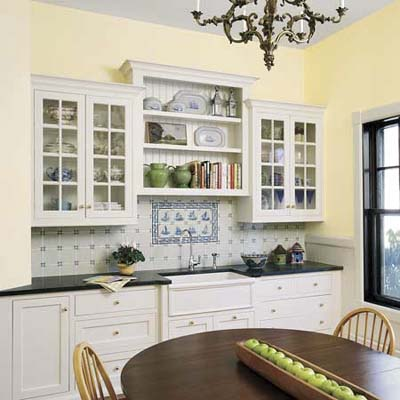 White open shelving and glass-front cabinets in this remodeled kitchen