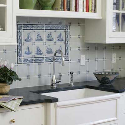 a delft-tile backsplash in this remodeled kitchen