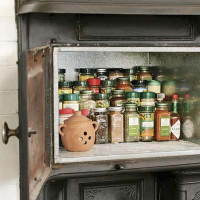 handy storage for spices and other small items in this remodeled kitchen