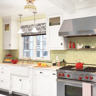 remodeled kitchen with green tile backsplash and white cabinetry