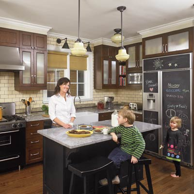 period style kitchen with island and chalkboard refrigerator panels