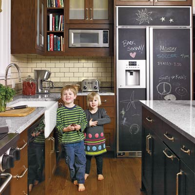 period style kitchen with chalkboard fridge panels
