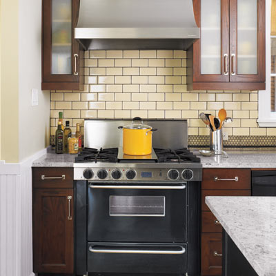period style kitchen with stainless steel range and hood with granite countertops