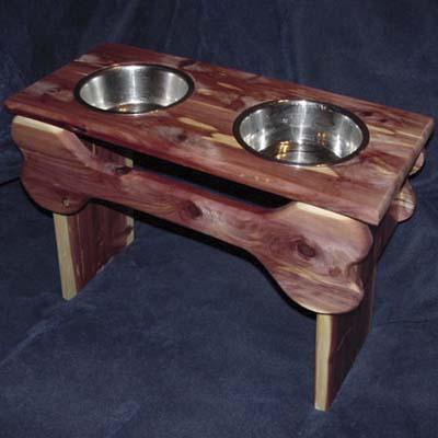 wood dog feeding station with bone accents