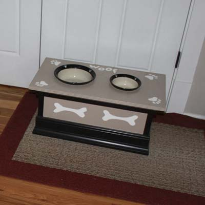 wood dog feeding station with bone accents